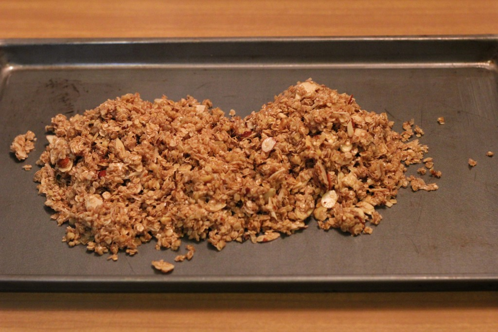 baked granola on cookie sheet
