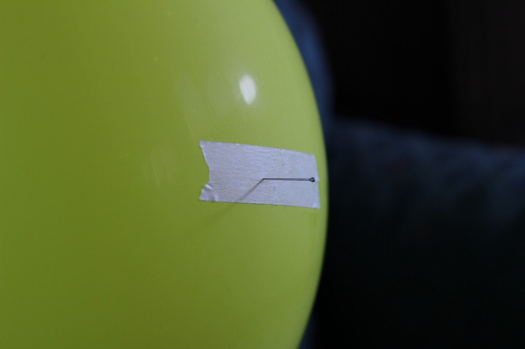 Pin in balloon doesn't pop